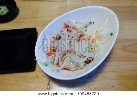 Delicious salad with crab sticks prepared for eating