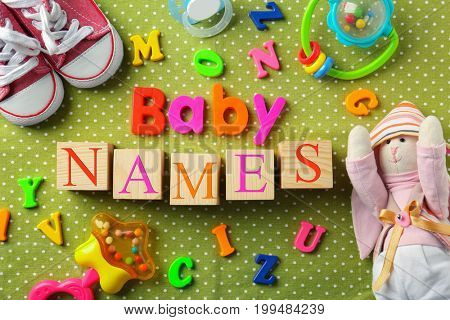 Composition with text BABY NAMES on color background