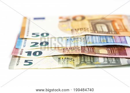 European union currency euro banknotes bills background. 5 10 20 and 50 euro. Concept success rich economy. On white background Europe