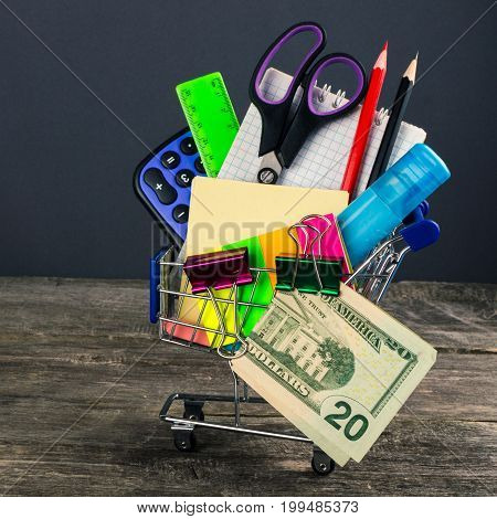 Shopping Cart With School Supplies. Back To School