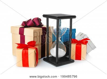 Hourglass and gifts on white background. Christmas countdown concept