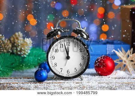 Retro alarm clock and decorations on table. Christmas countdown concept