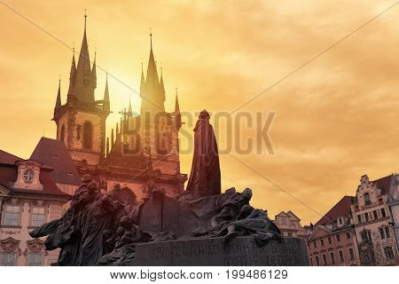 Church of Our Lady Tyn and Jan Hus statue from Old Town Square Staromestska Prague at sunset. Prague landmarks