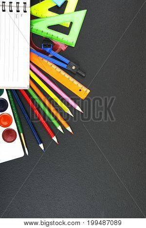 School supplies on blackboard background with copyspace for your text, design. Back to school concept for banner, promotion, web.