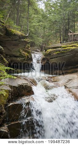 Water cascading down rocky hillside at Sabbaday Falls