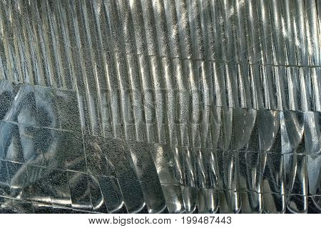 Textured Background Close Up of Car Headlight or Headlamp of The Vehicle with Abstract Effect.