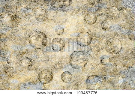Abstract textured background of floating circles in rough textured background
