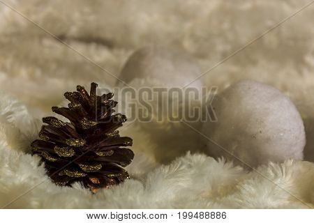 A nob and white snowy balls in the white snowy background. Christmas decoration.