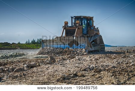 bulldozer a moving land shovel. A close up