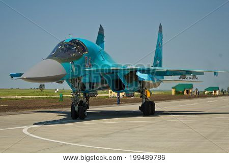 VORONEZH, RUSSIA - MAY 25, 2014: Russian military aircraft fighter-bomber Su-34 (RF-92252) is ready to take off from the airfield Baltimore