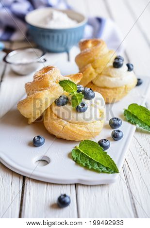 Cream Puffs Filled With Vanilla Cream And Blueberries