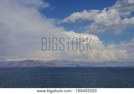 Clouds Over Lake Sevan And Mountain Range At Background. Gegharkunik Province, Armenia