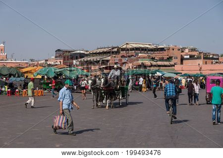 Marrakesh, Morocco - May 3, 2017: People in Jemaa el-Fna main square of Marrakech