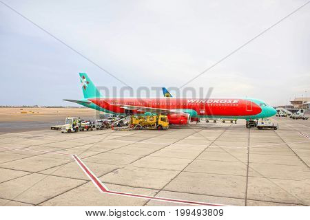 Sharm El Sheikh, Egypt - April 13, 2017: The loose luggage being loaded into narrow body aircraft at day at Sharm El Sheikh, Egypt on April 14, 2017