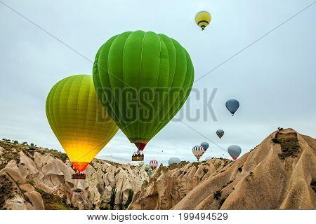 Flying balloons in Cappadocia, landscape, Anatolia, Turkey.