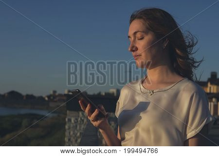 Portrait Of A Beautiful Woman Texting With Her Phone
