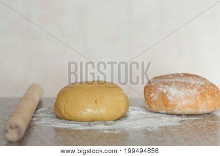 Dough, Bread In Flour On The Table