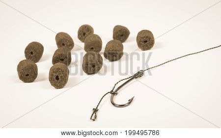 Carp Hook Pellets On The White Background . Closeup .