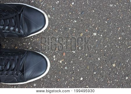 Black Road Asphalt Texture Pattern Background. Shoes.