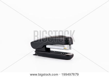 Black stapler isolated on white. Business and education background