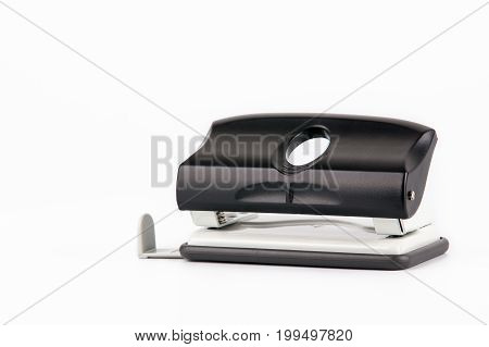 Paper puncher isolated on white. Business and education fbackground