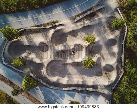 Aerial View Of Bike Track In Park With Trees And Roads