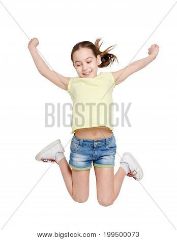 Happy girl jumping on white isolated background. Teenager in casual summer clothes smiling and posing. Active life and happy childhood concept