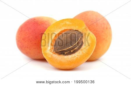 Isolated apricot. Fresh cut apricot fruits isolated on white background, with clipping path