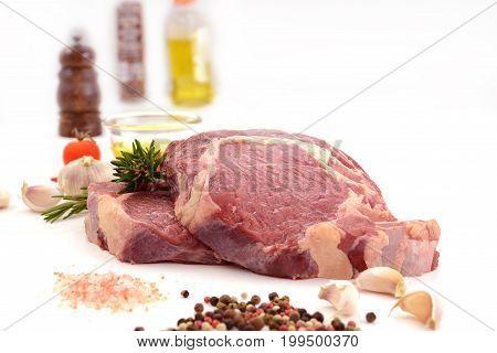 Raw meat beef steak isolated on white background (rib eye)