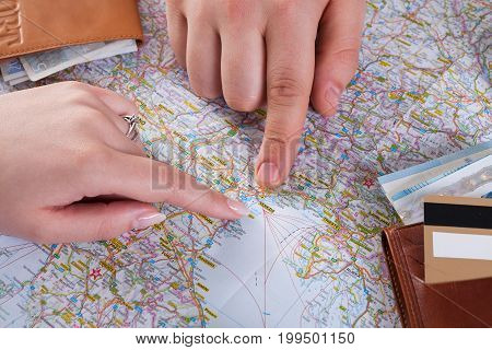 Couple planning trip to Venice, Italy, pointing on this city on map. Travel background with accessories