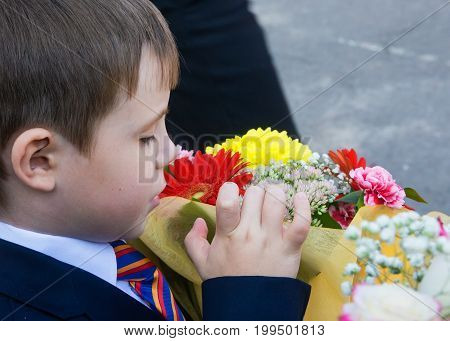 Voronezh Russia - September 01 2014: Russian small boy first-grader first time came to school on the feast of September 1