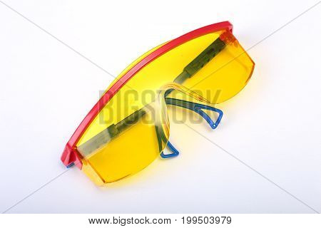 safety glasses for work. Eye protection during operation on a white background