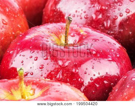 Macro of fresh red wet apples with water drops