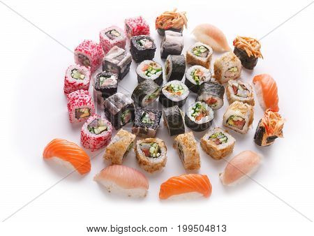 Big party sushi set isolated on white background. Japanese food delivery and take away. Fish and vegetable rolls, salmon and seabass nigiri, spicy gunkans