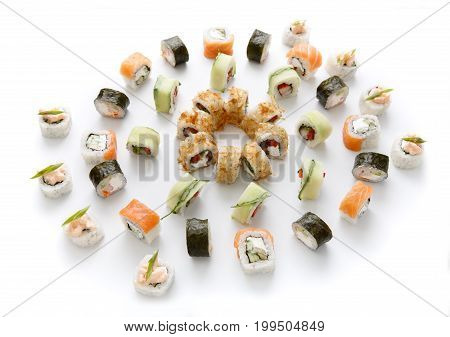 Sushi assortment isolated on white background. Big set of seafood rolls covered with nori, cucumber and dry eel flakes. Japanese food delivery
