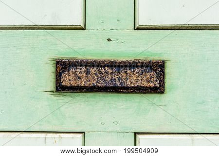 Vintage Metal Mail Slot In Door With Painted Green Wood
