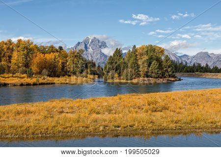 a scenic fall landscape along the snake river in the Tetons