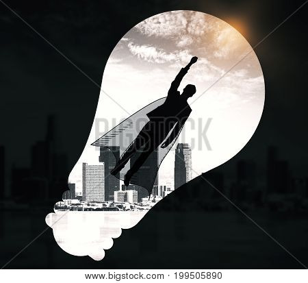 Abstract image of flying man hero with cape and light bulb silhouette on black city background. Courage concept