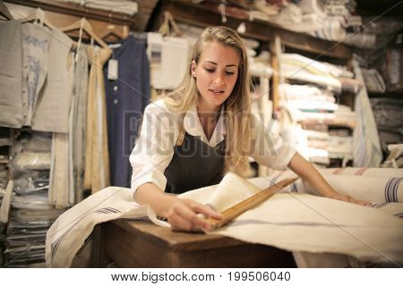 Young dressmaker at work