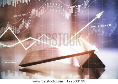 Tablet with abstract forex hologram. Finance concept. Toned image. Double exposure
