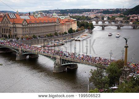 Participants Of The Prague Pride Are Crossing A Bridge