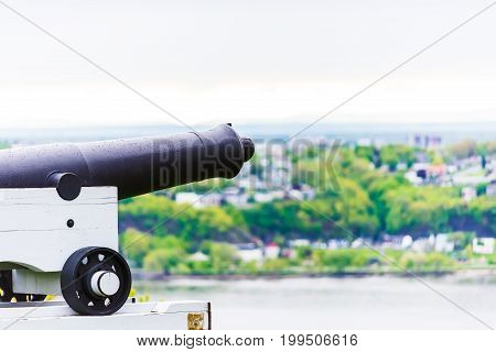 Cannon in Quebec City Canada in plaines d'Abraham overlooking the Saint Lawrence river and Levis town