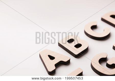 Wooden english letters background. Alphabet study, abc, education concept