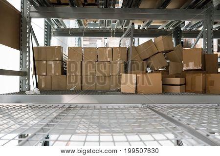 Abandoned Carton Boxes On Steel Racks