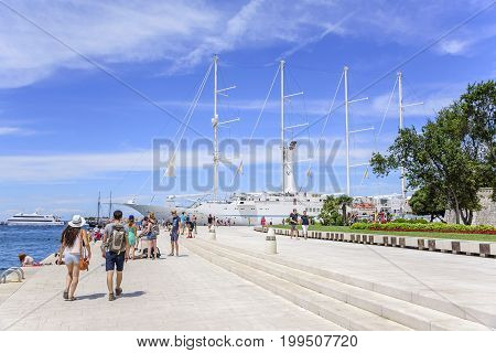 ZADAR, CROATIA - JULY 15, 2017: The embankment of the city of Zadar on a sunny summer day. Zadar, one of the most popular cities in Croatia in the tourist season.