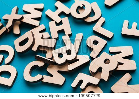 Pile of wooden english letters background, copy space. Alphabet study, abc, education concept