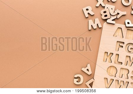 Wooden board with English alphabet letters. Sorter toy for child development and education.