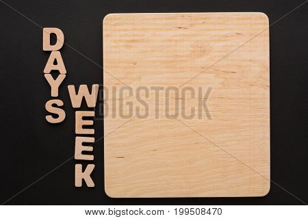 Wooden board with Week Days sign, copy space. Timetable, to-do-list, time management concept