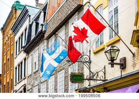 Quebec City Canada - May 30 2017: Tatouage Biron Fils flags sign for restaurant in upper old town street called Rue Garneau closeup