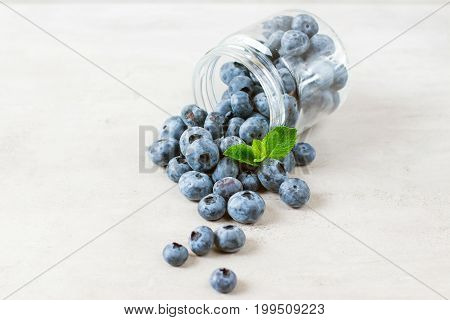 Blueberries on the white wooden table, healthy food